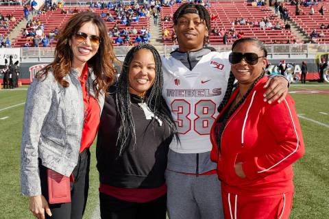 UNLV's Ty'Jason Roberts stands on the field with, from left, UNLV athletic director Desiree Ree ...