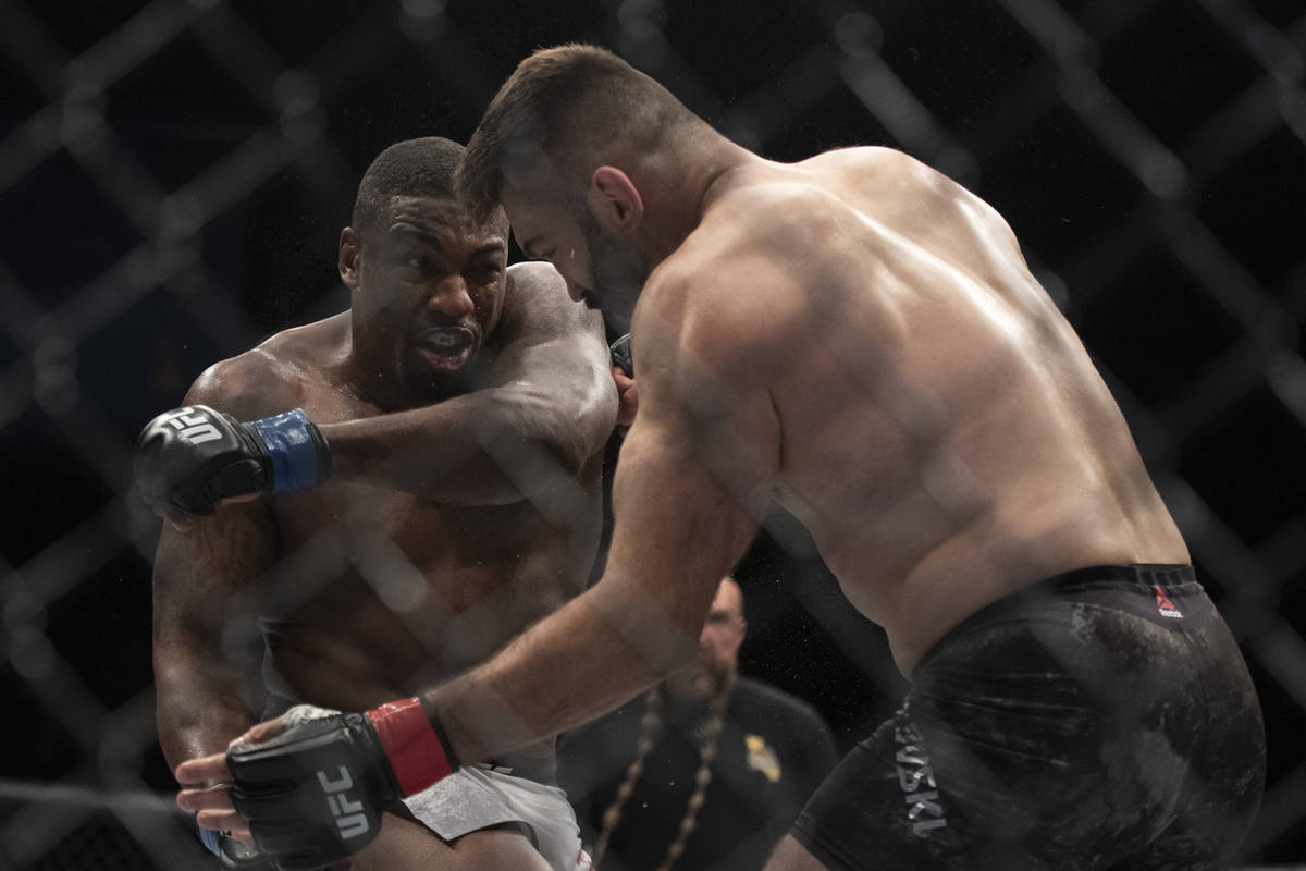 Walt Harris, left, follows through on a punch to Andrei Arlovski during the first round of a he ...