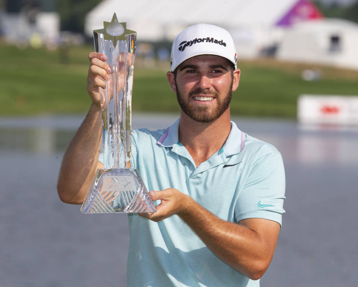 Matthew Wolff holds the trophy after winning the 3M Open golf tournament Sunday, July 7, 2019, ...