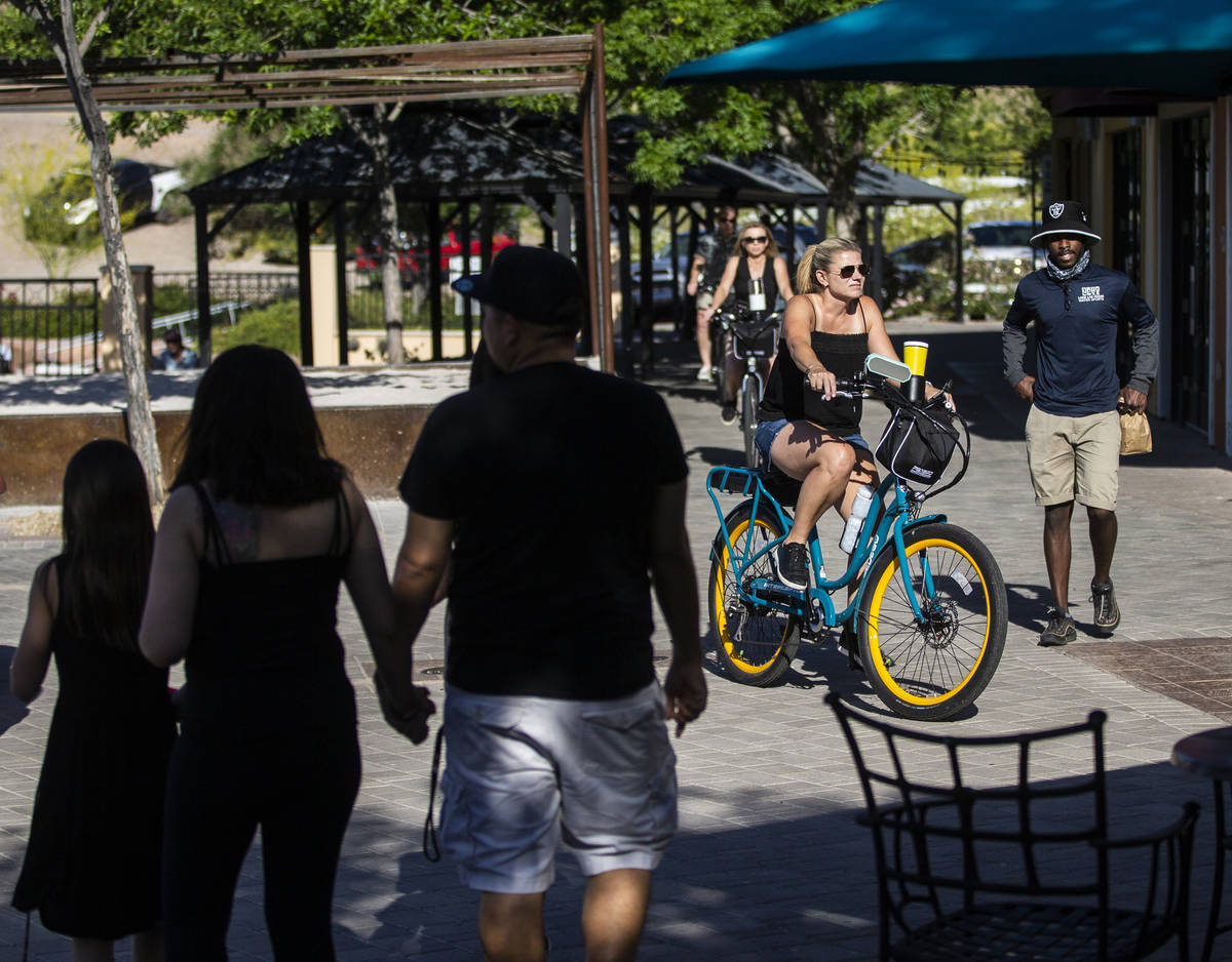 People enjoy the outdoor shops and restaurants at Lake Las Vegas on Friday, May 15, 2020, in He ...