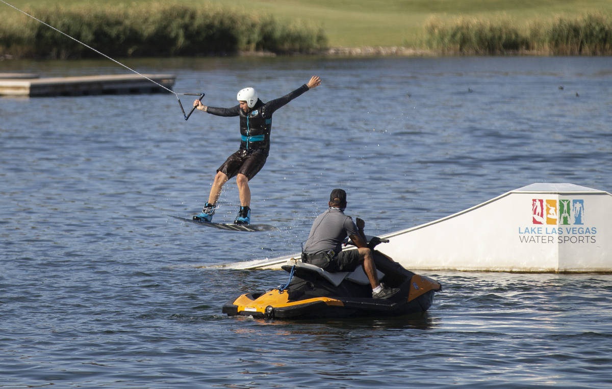 Jash Metz, with Lake Las Vegas Water Sports, wakeboards with a weight cable on Friday, May 15, ...