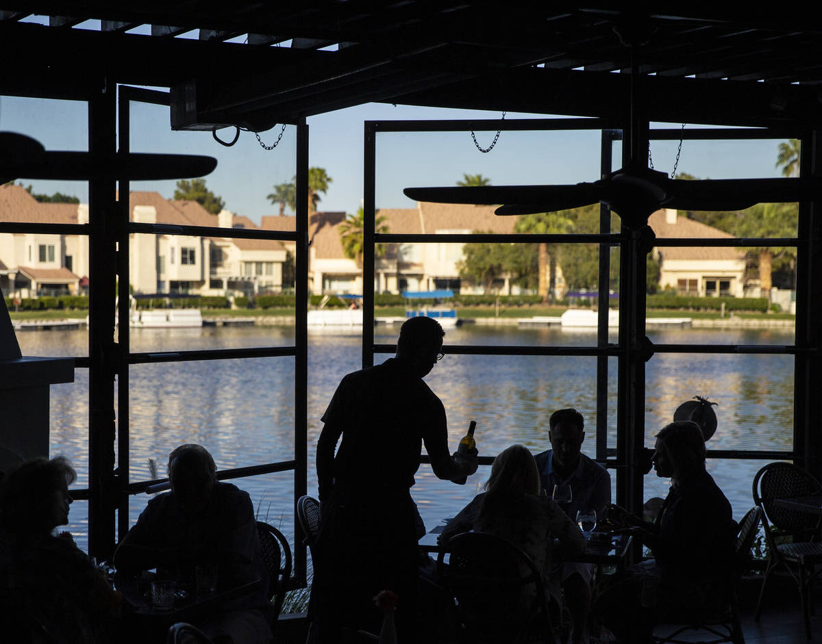 Diners enjoy a meal on the patio at Marché Bacchus on Friday, May 15, 2020, in Las Vegas. ...