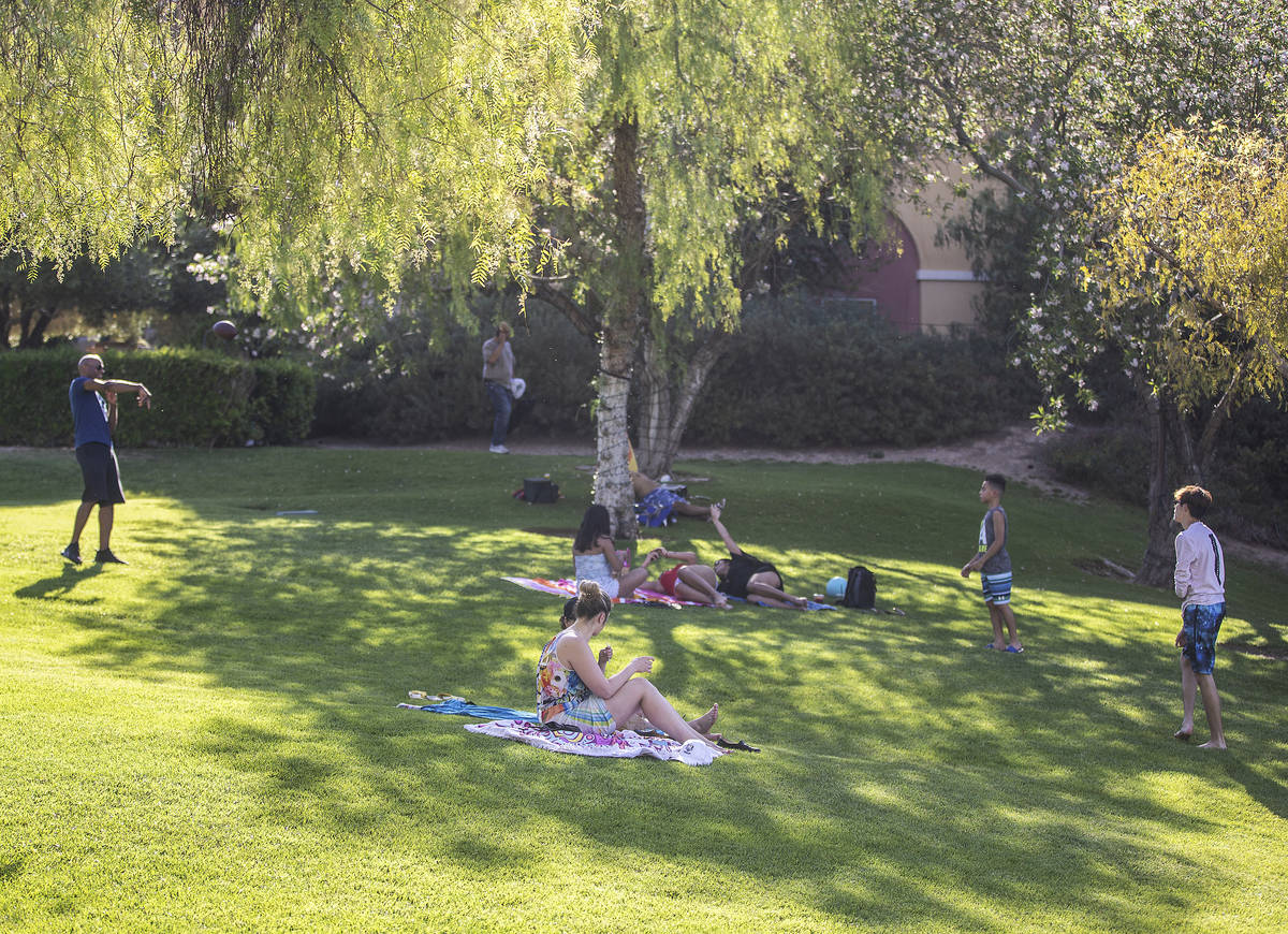 People relax outside at Lake Las Vegas on Friday, May 15, 2020, in Henderson. (Benjamin Hager/L ...