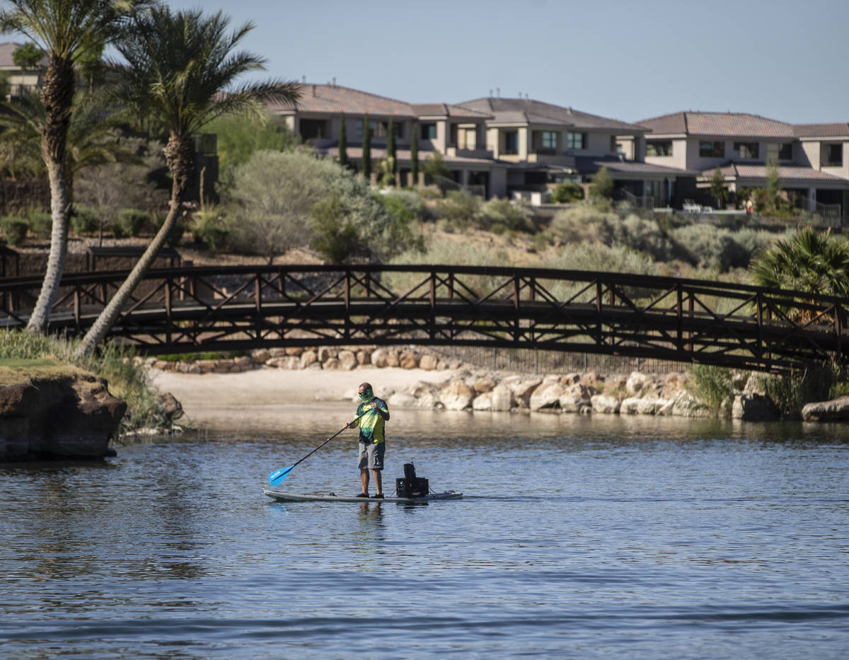 A paddle boarder passes under a bridge at Lake Las Vegas on Friday, May 15, 2020, in Henderson. ...