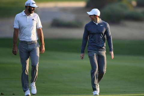 FILE - In this Jan. 18, 2018, file photo, Dustin Johnson of the United States, left, and Rory M ...