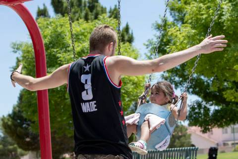 Rhiannon Fitzgerald, 3, swings toward David Cotterell at Pioneer Park on Saturday, May 16, 2020 ...