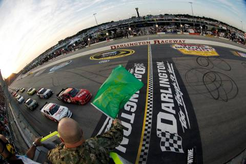FILE - In this May 11, 2012, file photo, drivers take the green flag for the start of the NASCA ...