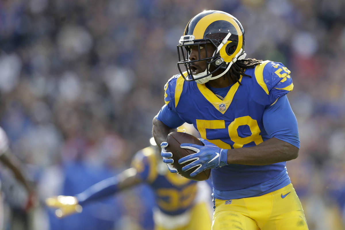 Los Angeles Rams inside linebacker Cory Littleton scores on a interception against the San Fran ...