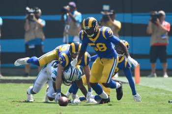 Carolina Panthers wide receiver D.J. Moore fumbles while Los Angeles Rams inside linebacker Cor ...