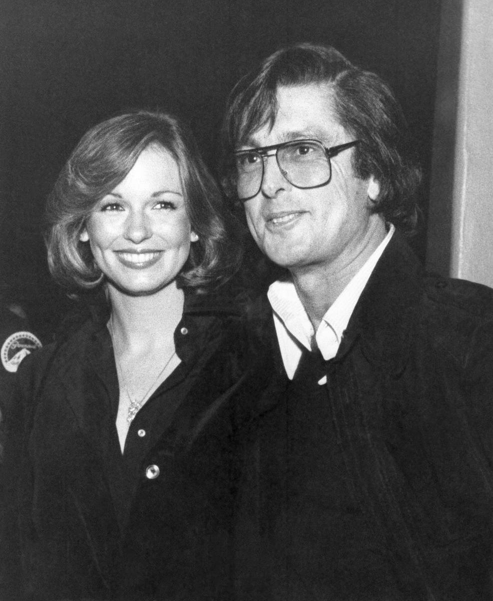 In this 1977 photo, Movie producer Robert Evans, right, is seen with television sports commenta ...