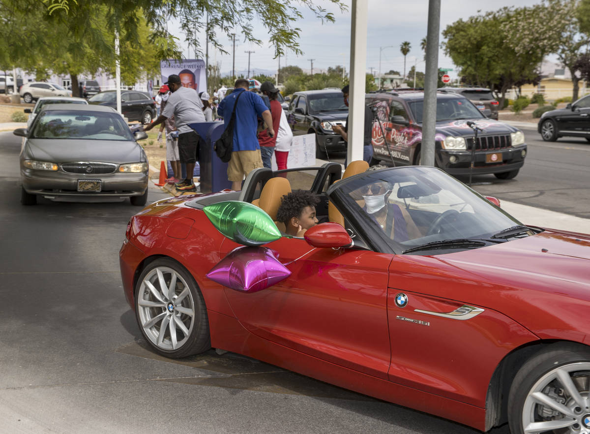 Drivers navigate past the reception area during a mail ballot drop-off parade at the at the U.S ...