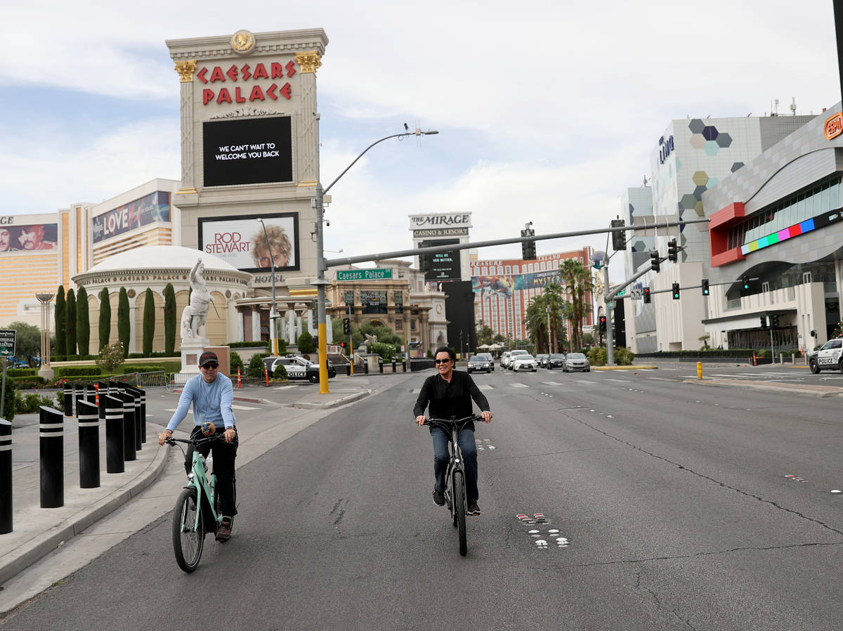 Mr. Las Vegas Wayne Newton, right, rides a bicycle on the Strip in Las Vegas with Las Vegas Rev ...