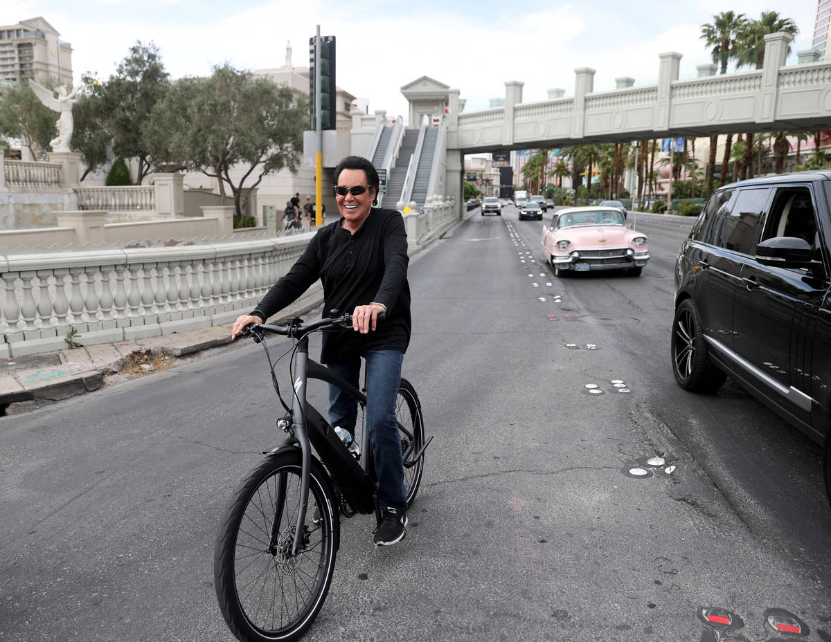 Mr. Las Vegas Wayne Newton rides a bicycle on the Strip in Las Vegas Saturday, May 16, 2020. (K ...