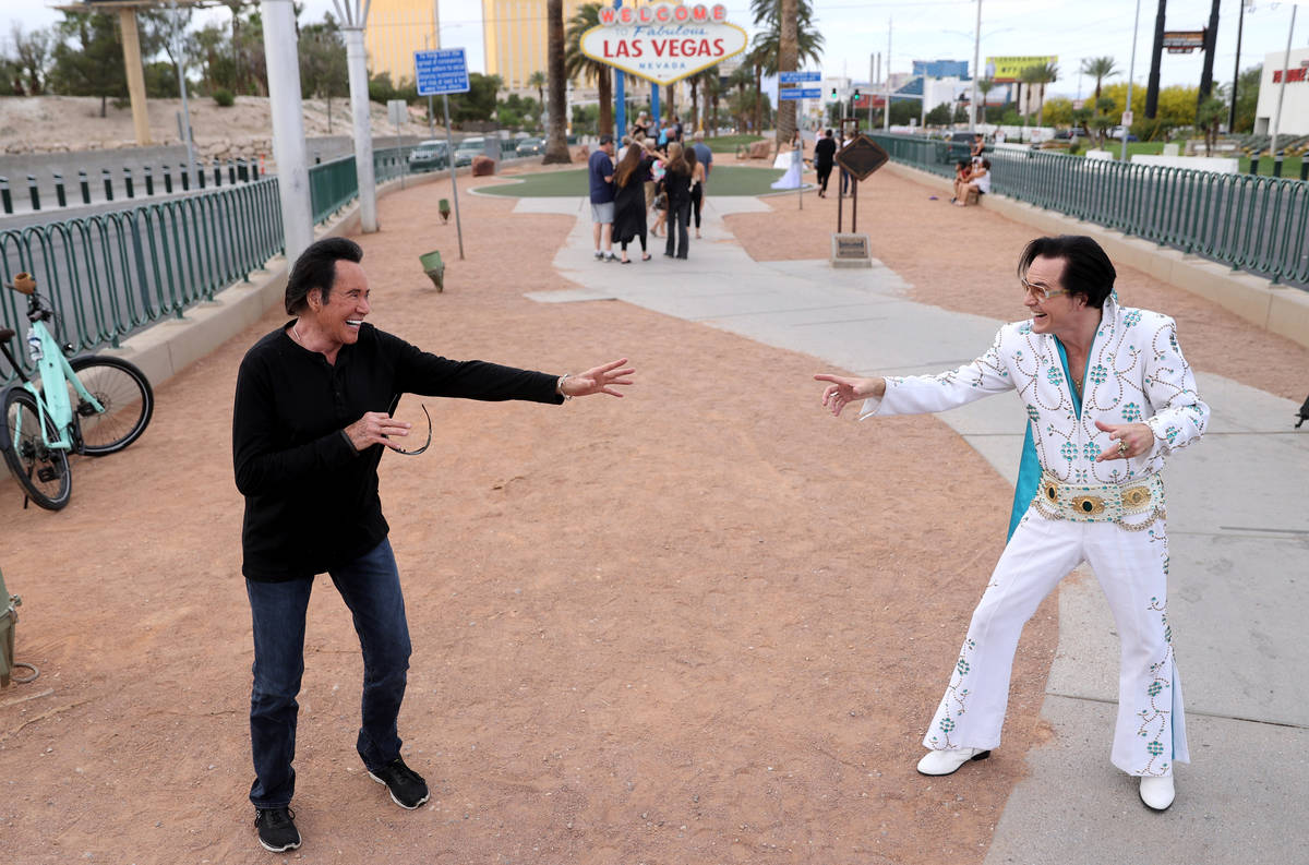 Mr. Las Vegas Wayne Newton, left, keeps social distance from Eddie Powers as Elvis at the Welco ...