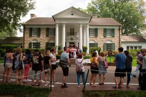 FILE - In an Aug. 15, 2017 file photo, fans wait in line outside Graceland, Elvis Presley's Mem ...