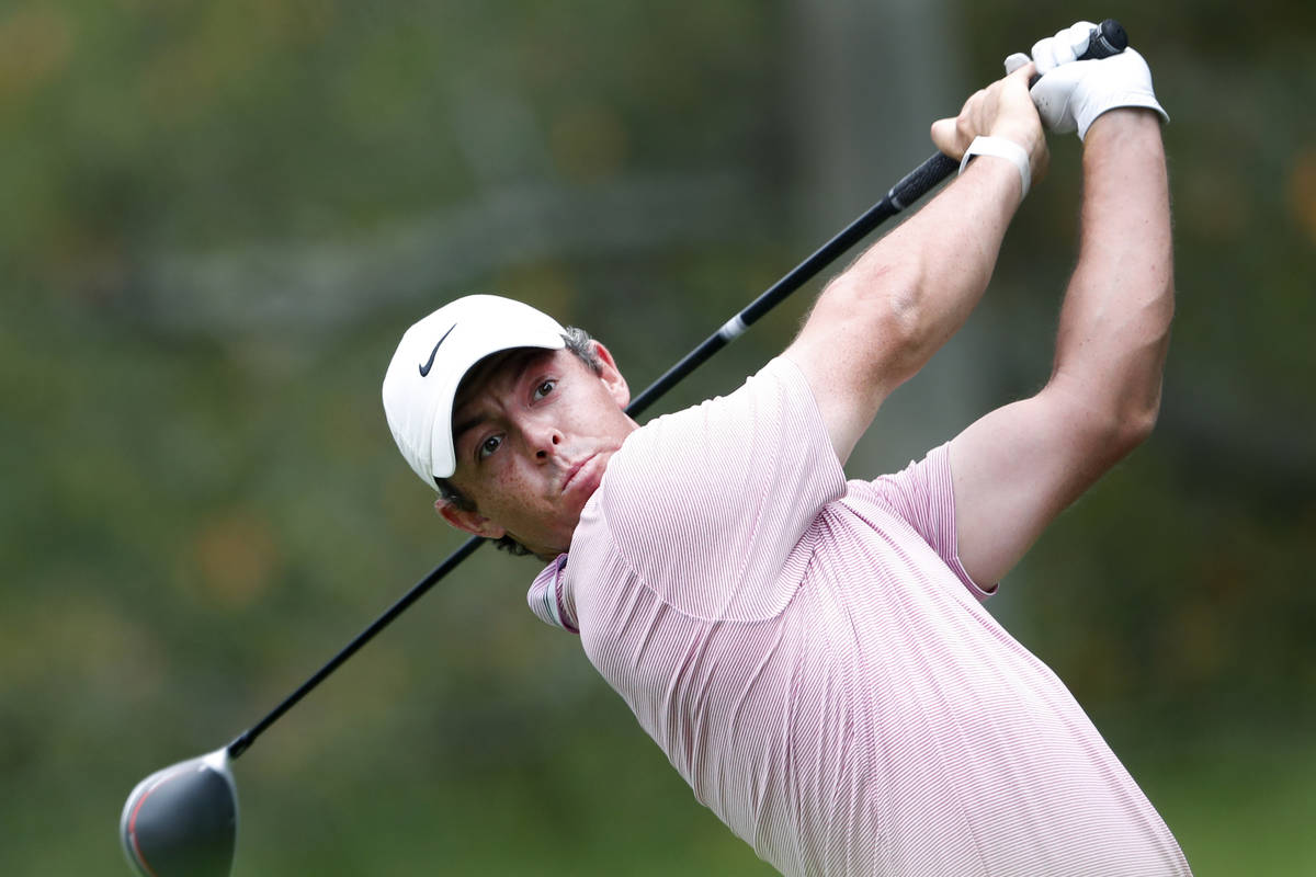Rory McIlroy hits from the fifth tee during the final round of the Tour Championship golf tourn ...