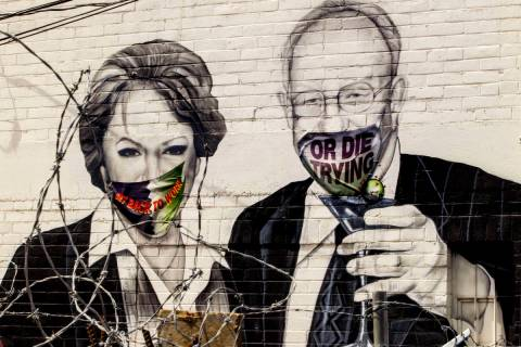 Mayor Carolyn Goodman and husband Oscar are portrayed in a mural now wearing face masks along a ...