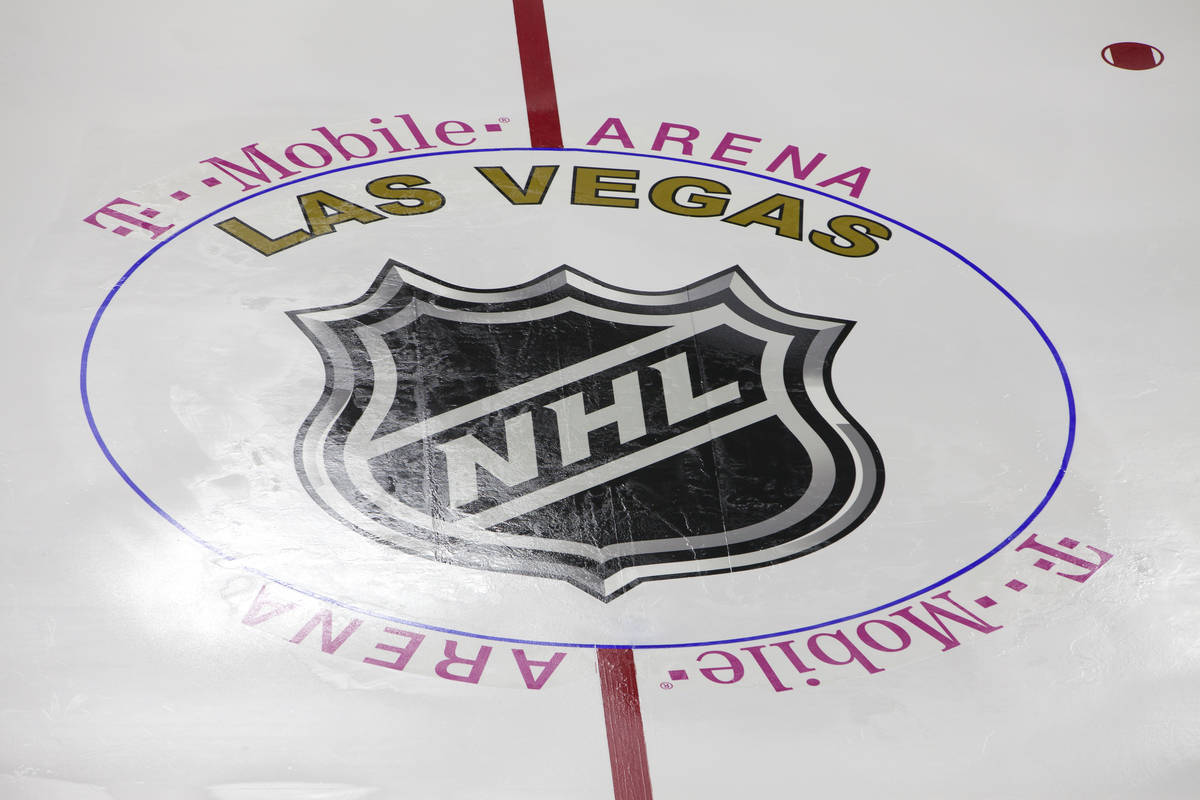 The Las Vegas NHL temporary logo is installed on the NHL rink at the T-Mobile Area in Las Vegas ...