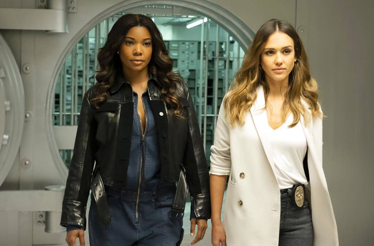 """An image released by FOX hows Gabrielle Union, left, and Jessica Alba in a scene from """"L.A.'s F ..."""