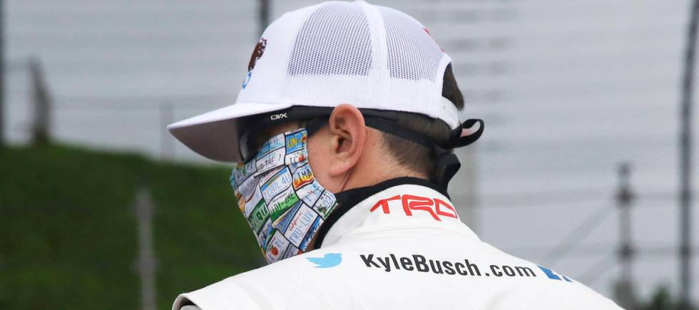 Kyle Busch wears a message to coronavirus pandemic responders on his back as he waits for the s ...