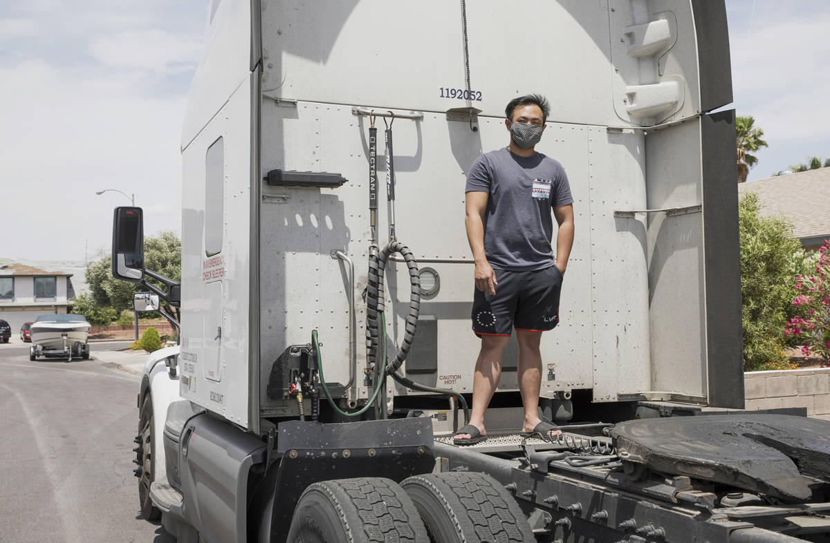 Kim Santiago, an over-the-road truck driver, outside his truck at his home in Las Vegas on Sund ...