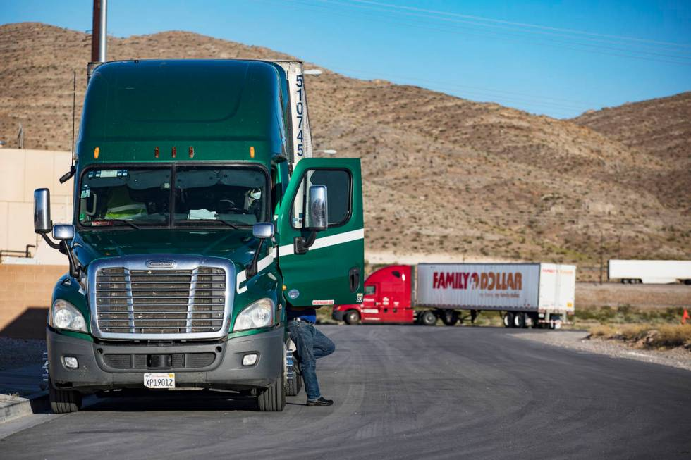 A truck driver rests at Love's Travel Stop in North Las Vegas on Tuesday, May 5, 2020, during ...
