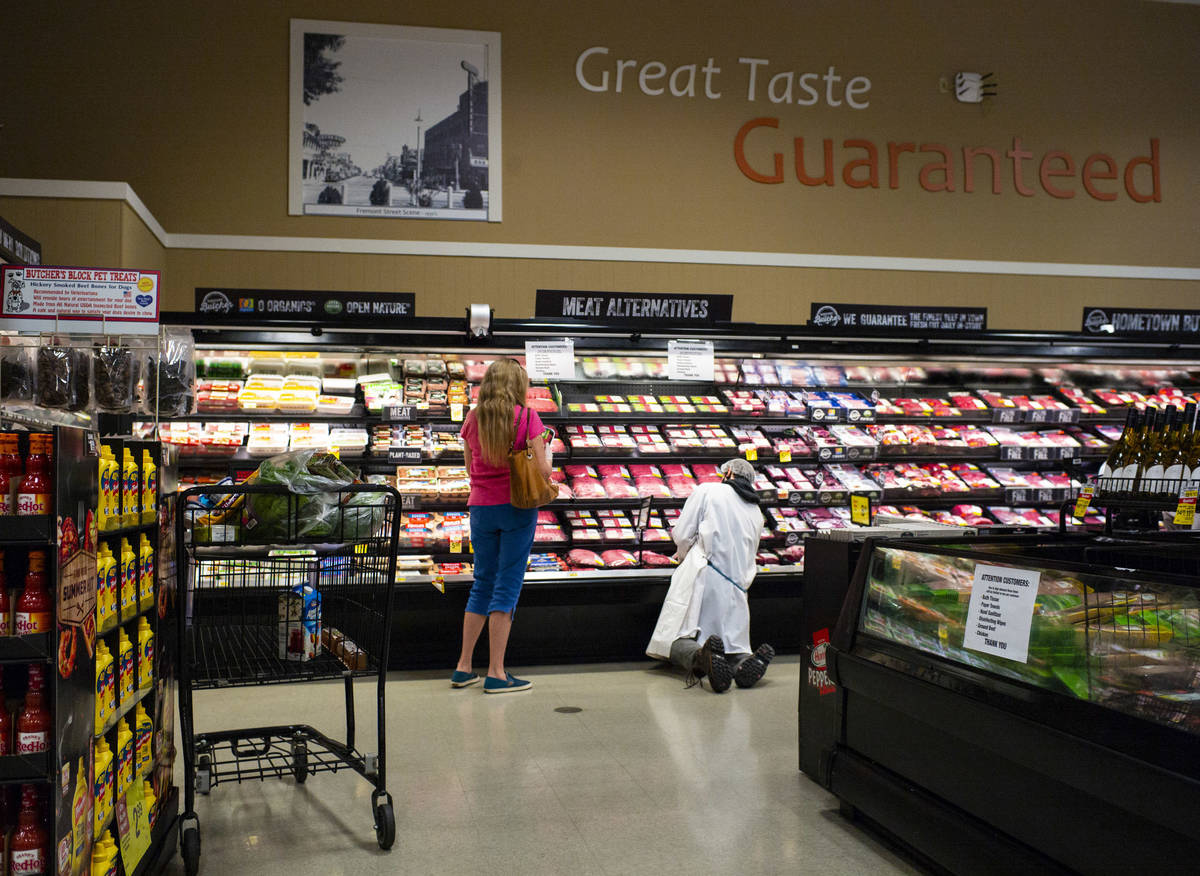 A worker stocks shelves in the meat section at Albertsons in Las Vegas on Saturday, May 2, 2020 ...