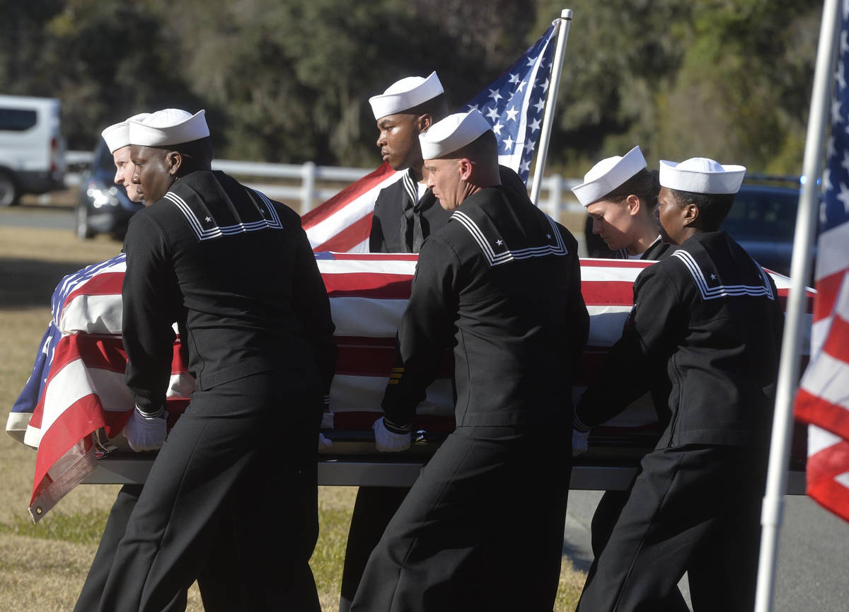 FILE - In this Dec. 16, 2019 file photo, sailors carry the casket of Cameron Walters at Oak Hil ...