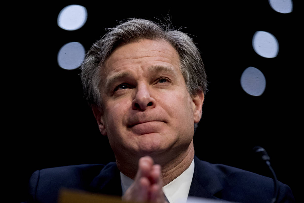 FILE - In this Nov. 5, 2019 file photo, FBI Director Christopher Wray pauses while testifying b ...
