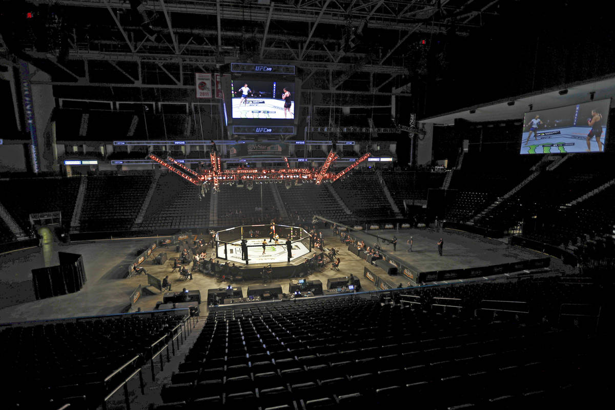 Fighters battle without spectators during a UFC 249 mixed martial arts bout, Saturday, May 9, 2 ...