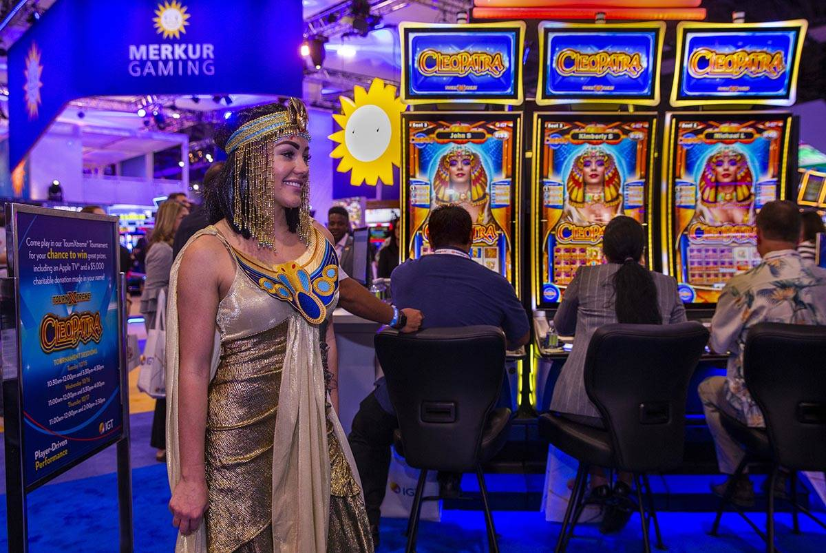 Cleopatra is on hand as attendees play the game on display in the IGT exhibition space during t ...