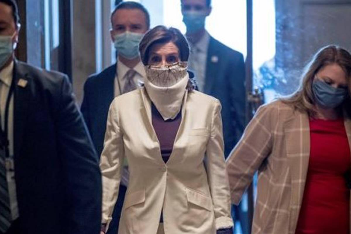 House Speaker Nancy Pelosi of California walks on Capitol Hill, Thursday, April 23, 2020, in Wa ...