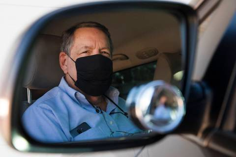 David Shapin, normally a full-time Uber and Lyft driver, in his car at his home in Las Vegas, M ...