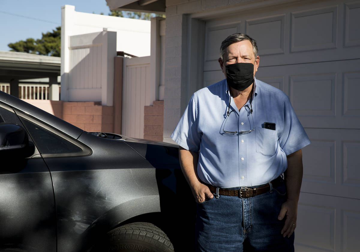 David Shapin, normally a full-time Uber and Lyft driver, next to his car at his home in Las Veg ...