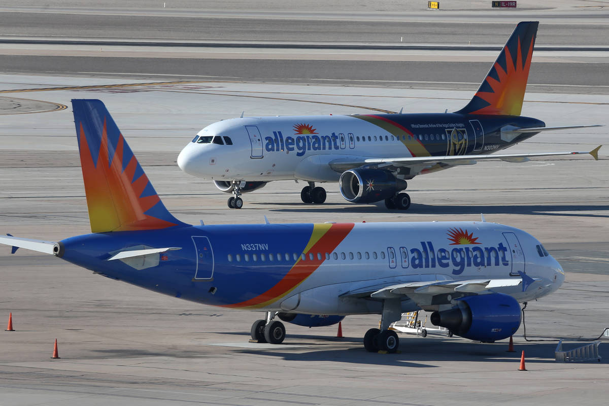 Two Allegiant Air airplanes taxi at McCarran International Airport in Las Vegas on Tuesday, Jan ...