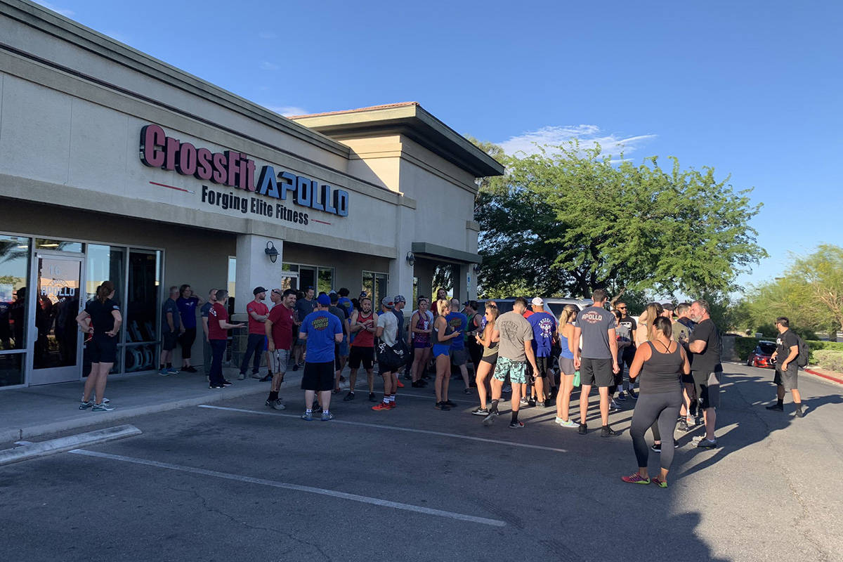 A large group gathered Monday, May 18, 2020, outside CrossFit Apollo in the northwest valley. ( ...