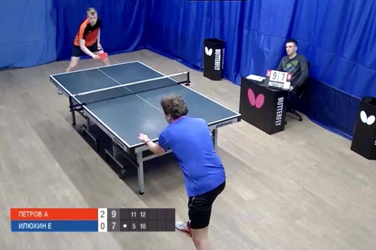Evgeniy Ilyukhin (in blue) faces off against Aleksandr Petrov in a Moscow Ligo Pro table tennis ...