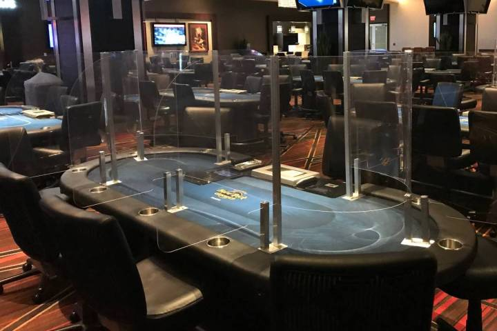Poker tables with plexiglass dividers are being used at the Seminole Hard Rock casino in Tampa, ...