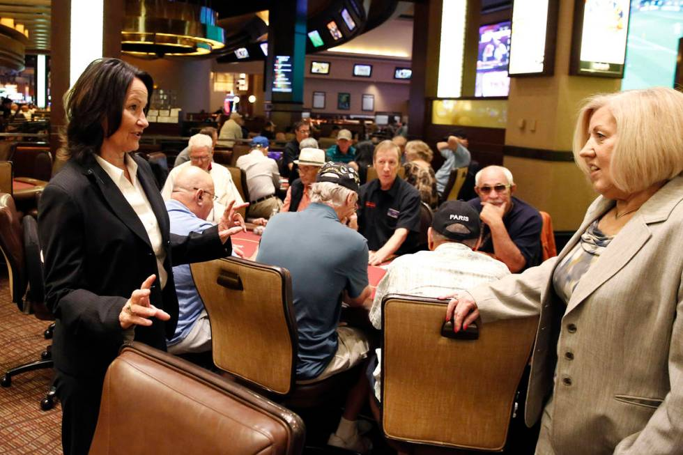 Tracy Mendiola, left, talks to Kathy Raymond, right, both poker rooms managers at the Station C ...