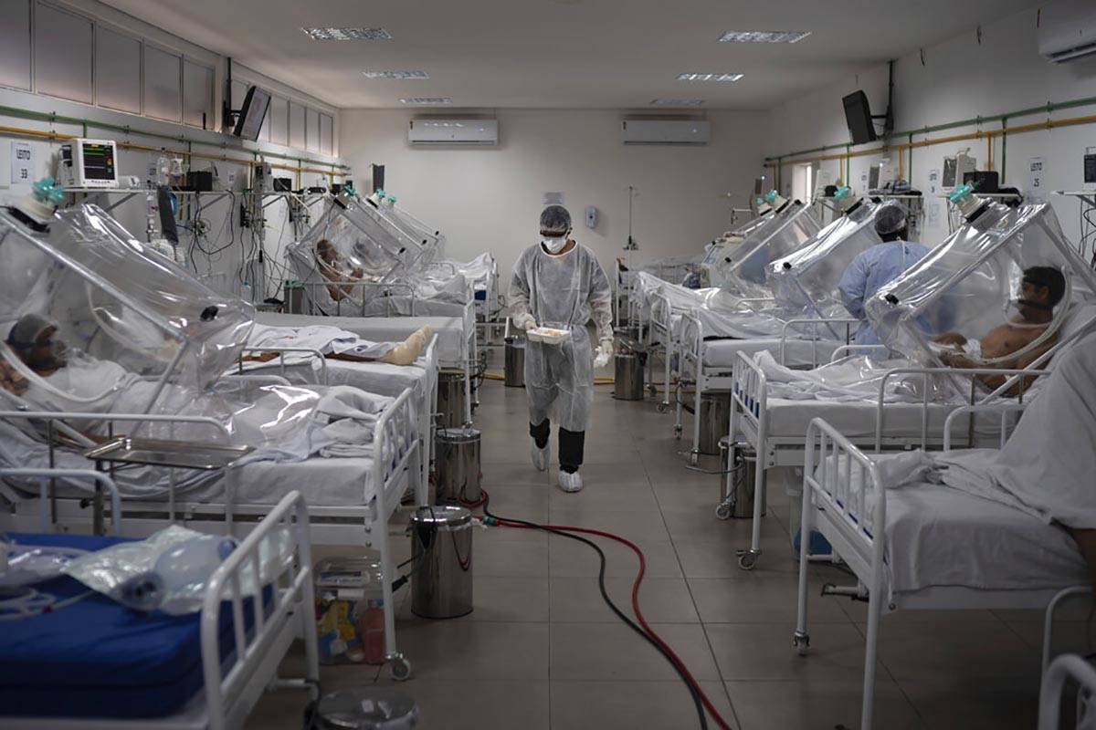 COVID-19 patients are treated inside a non-invasive ventilation system named the 'Vanessa Capsu ...