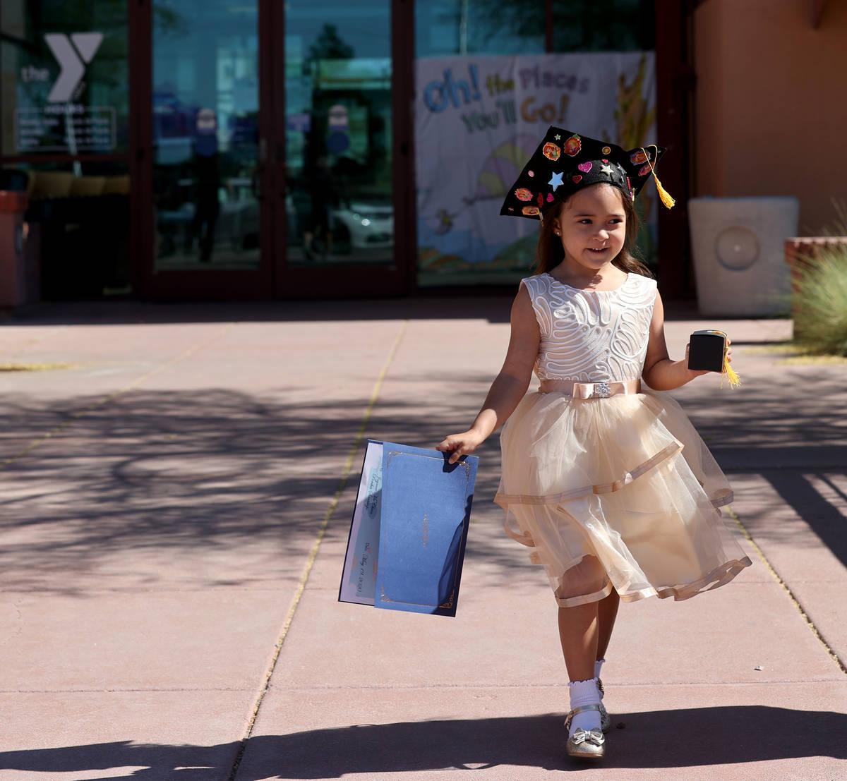 J'Lysia Topscher, 5, during drive-thru graduation for preschoolers at SkyView YMCA in Las Vegas ...