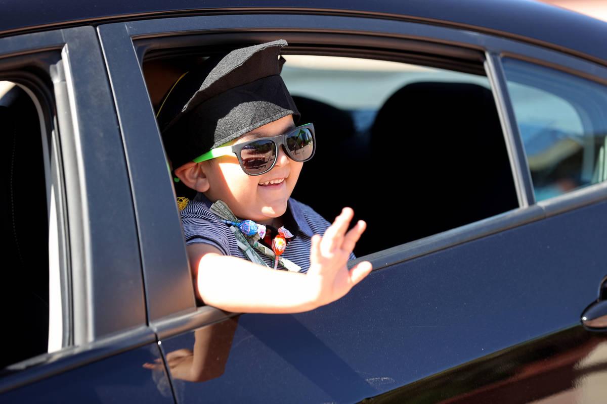 Julian Acosta, 4, drive-thru graduation for preschoolers at SkyView YMCA in Las Vegas Tuesday, ...
