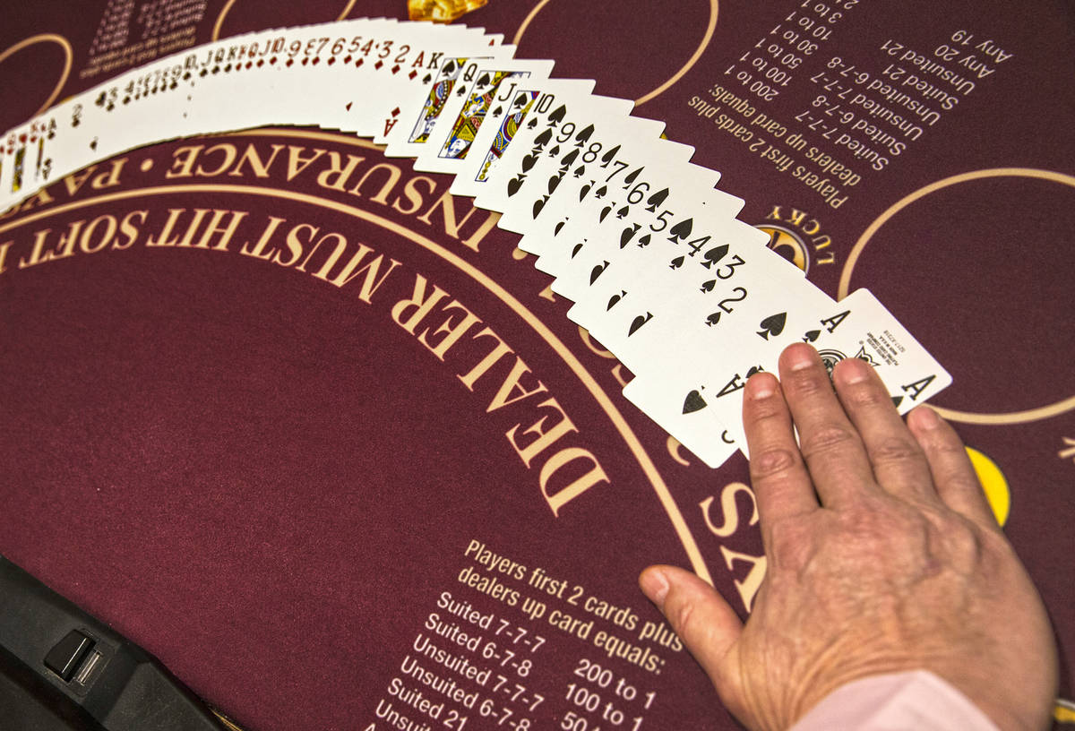 A dealer displays cards at MGM Grand hotel-casino in Las Vegas on Thursday, April 19, 2018. (Be ...