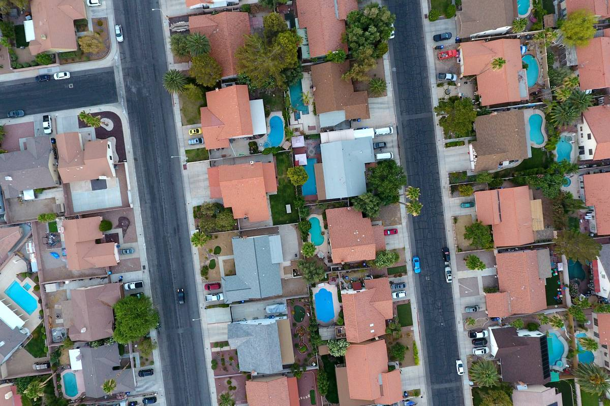 This aerial file photo shows home on Valle Verde Drive and Warm Springs Road in Henderson. (Mic ...