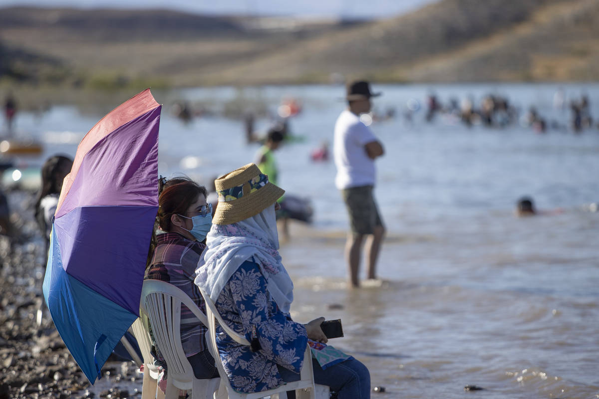 Few wore masks at Boulder Beach at Lake Mead National Recreation Area on Memorial Day on Monday ...