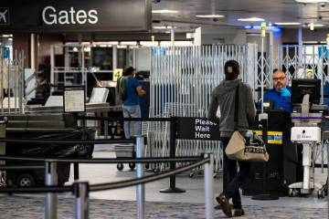 Passengers stop by a Transportation Security Administration checkpoint at McCarran Internationa ...