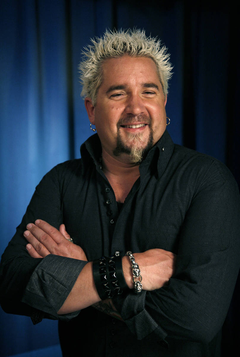 This Wednesday, May 4, 2011 file photo shows Guy Fieri as he poses for a portrait in New York.( ...