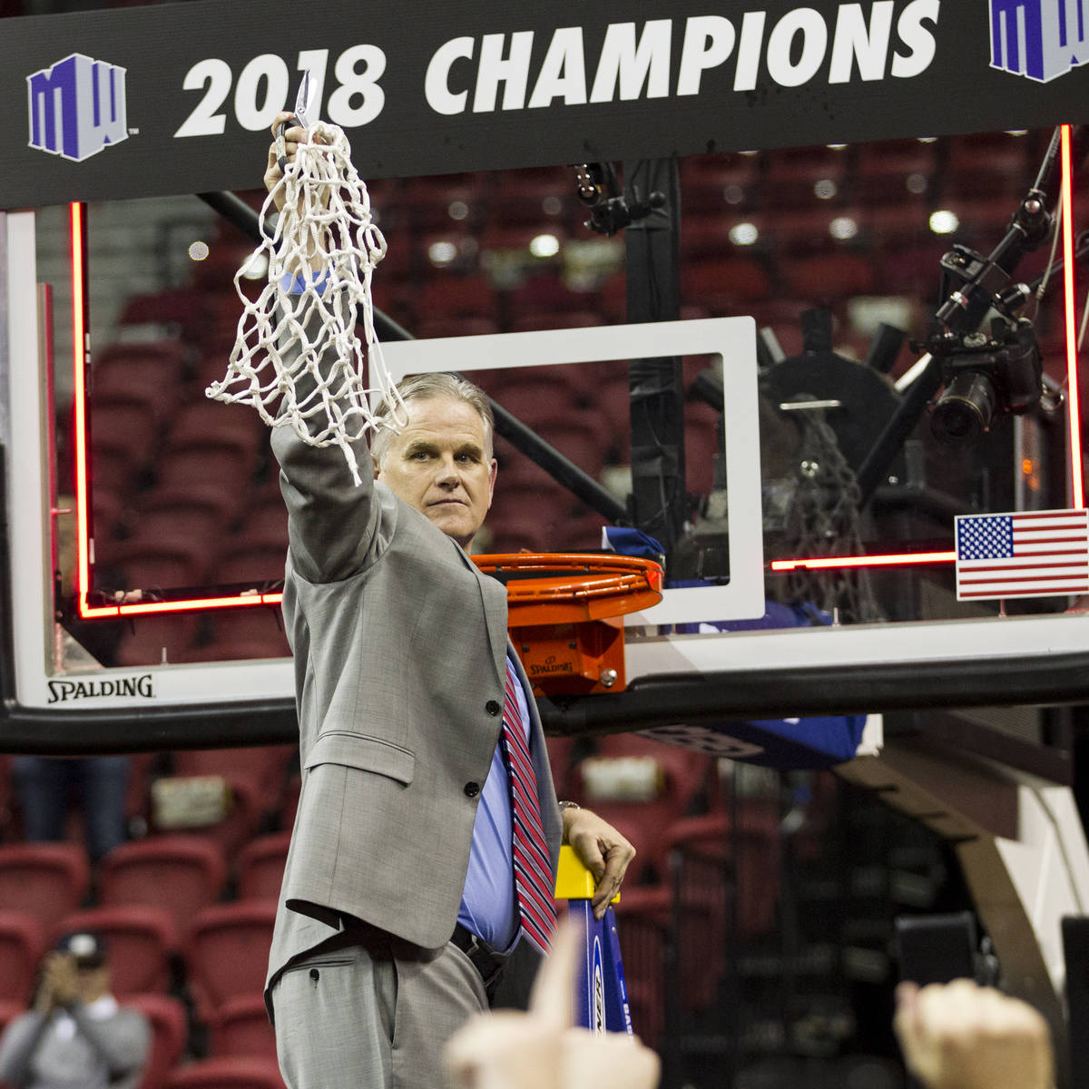 San Diego State Aztecs head coach Brian Dutcher after cutting down the net following a win agai ...