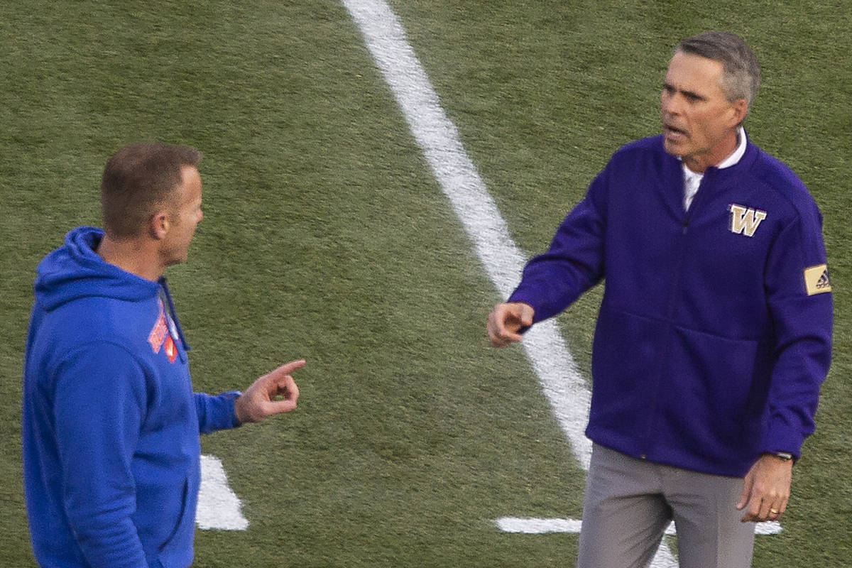 Boise State Broncos head coach Bryan Harsin and Washington Huskies head coach Chris Petersen ch ...
