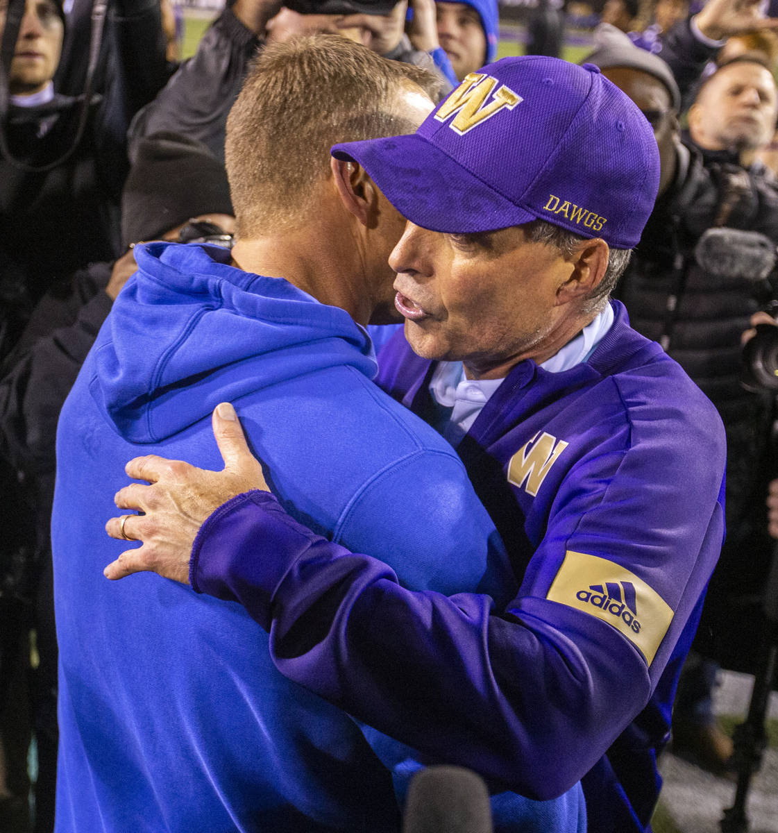 Boise State Broncos head coach Bryan Harsin, left, embraces Washington Huskies head coach Chris ...